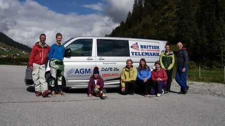 Jasmin Taylor, sitting, with her GB Telemark colleagues in front of the team's new van, which was sp