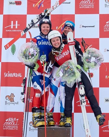 Jasmin Taylor, front (in red) on the podium after a Telemark World Cup race in Hurdal, Norway