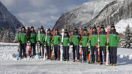 The GB Telemark team. Jasmin Taylor is in the centre, holding white skis
