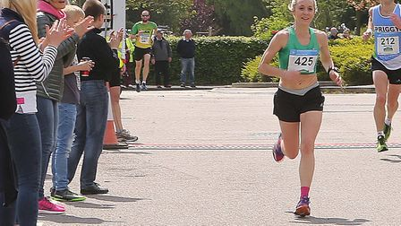 Marie Shirley approaches the finish to win the Halstead Marathon. Shirley is a member of Colchester