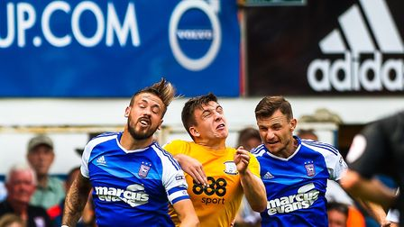 Luke Chambers and Tommy Smith take on Preston North End's Jordan Hugill during the Ipswich Town v Pr