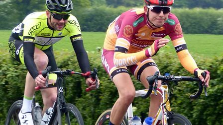 Gary Freeman (left) and eventual winner George Clark lead at the Pro Cycle Hire Road Race