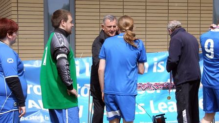 Ipswich Town legend and FA Cup final hero, Roger Osborne, presents the mementos at the Ability Count
