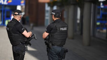 Armed police walking around the APEX venue in Bury St Edmunds as part of a counter terrorism program