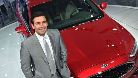 Mark Fields, president and chief executive of Ford Motor Company, with the 2017 Ford Fusion at the N