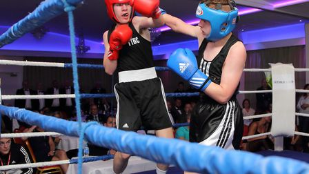 Declan White, left, in action against Charlie Grant at the Eastgate Boxing Club show. Picture: PAUL