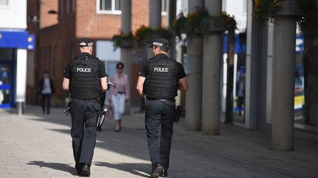 Armed police walking around The Apex in Bury St Edmunds as part of a counter terrorism program.