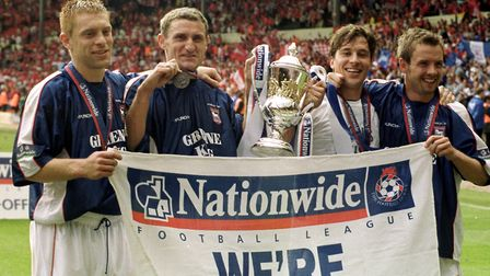 Ipswich Town players, Richard Naylor, Tony Mowbray, Martijn Reuser and Marcus Stewart celebrate on t