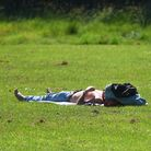 Sunbathers enjoying the hot temperatures in Broomhill Park, Ipswich. Picture: GREGG BROWN
