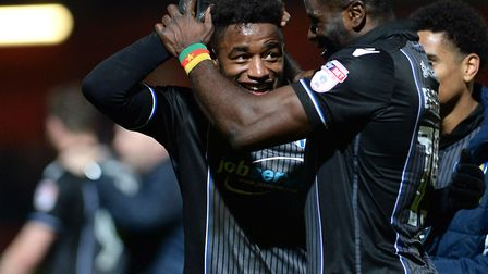 Tarique Fosu is congratulated by George Elokobi at Stevenage after scoring the U's fourth goal in a