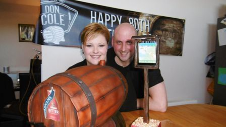 Angie and Stuart Harris with a working beer barrel cake, made for an 80th birthday celebration