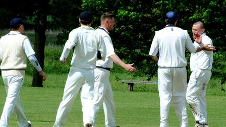 Worlington's Graham Downey, right, celebrates taking the wicket of Braintree's Will Jackson during t