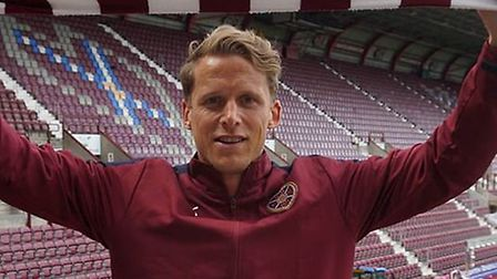 Released Ipswich Town defender Christophe Berra has signed for Hearts.