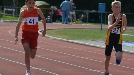 Joel Burgess, right, on his way to victory in the under-13 boys' 100m final. Picture: BEN POOLEY