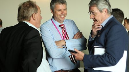 Sean Chenery, Galloper OM Manager, centre, and Simon Gray, right, from EEEGR chat to a guest at the