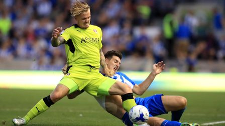 Danny Ward, (left) battles for possession of the ball with Brighton and Hove Albion's Lewis Dunk, la