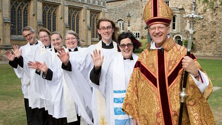 Bishop Martin Seeley, with newly ordained priests, from left, Simon White, Karen Burton, Charlotte C