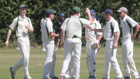 East Bergholt fielders celebrate the dismissal of Mark Burch, who was caught by Ian Gedney off the b