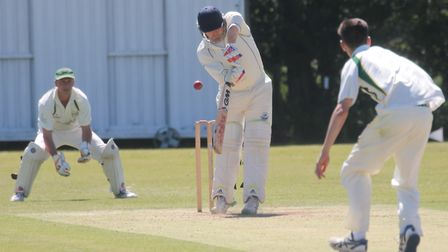 Ipswich captain Joe Rusby faces East Bergholt bowler Jamie McGrath. Rusby top-scored with 86. Pictur