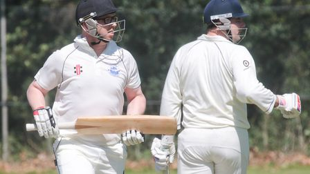 Ipswich batsmen Chris Norton and Joe Rusby watch the ball go to the boundary during their match agai