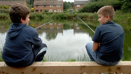 Louie Samuels, 10, left, and Tyler Cutbush, 9, enjoying a peaceful spot of fishing at Bartles Lodge