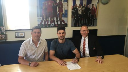 New Needham Market signing Jamie Griffiths (centre), flanked by manager Richard Wilkins (left) and c
