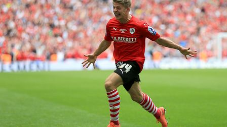 Lloyd Isgrove celebrates scoring in the League One Play-Off Final for Barnsley. Photo: PA