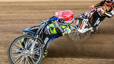 A flying Danny King leading Sam Masters during heat one at Foxhall