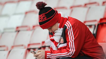 A Sunderland fan contemplates their club's relegation following a decade in the Premier League. The