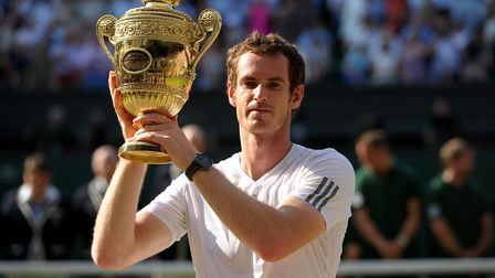 Andy Murray celebrates with the Wimbledon trophy after defeating Novak Djokovic in the 2013 Men's Fi