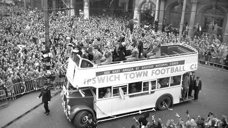 The triumphant Town team arrives on the Cornhill in Ipswich in the traditional open-top bus to be gr