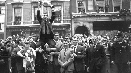 Andy Nelson doesn't look especially comfortable as he is hoisted skyward by John Elsworthy and Roy B