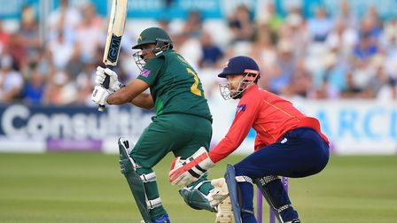 Nottinghamshire's Samit Patel (left) and Essex's James Foster in action at Chelmsford last night