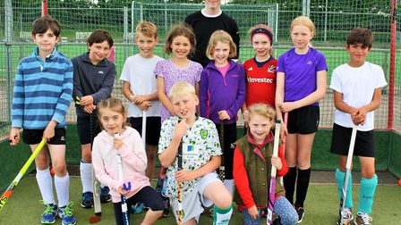 Seth Read, a Magpies coach, with some of the youngsters at the hockey taster course. Photo: Bex Pott