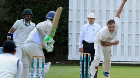 Michael Comber, who took seven for 59 in the first innings and then took two early wickets in the se