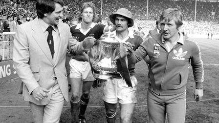 Bobby Robson (left) with coach Cyril Lea and players David Geddis and captain Mick Mills (hat) as th