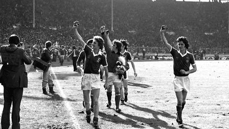 Ipswich goalkeeper Paul Cooper doing a lap of honour after the match; George Burley, right