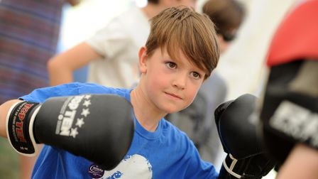 Families enjoyed the Sports Village at the Suffolk Show 2017. Harry Turner having a go at boxing.