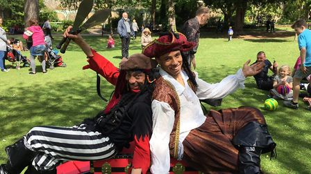 The Acropirates entertain with street theatre in the Abbey Gardens as part of the Bury Festival line