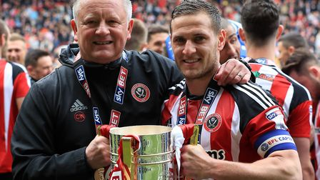 Sheffield United manager Chris Wilder and top-scorer Billy Sharp hold the the League One trophy. Pho