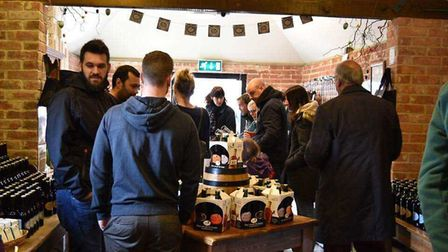 Visitors on the brewery shop at St Peter's Brewery, at St Peter South Elmham, near Bungay.