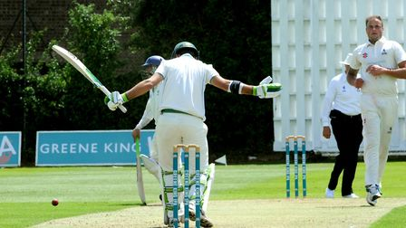 Suffolk's Michael Comber bowls to Michael Payne