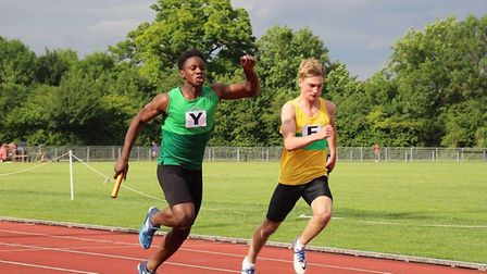 Graig Anya Joseph (green vest) takes first place for Colchester Harriers in an exciting finish to th