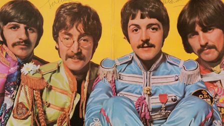 """The inside of The Beatles' """"Sgt. Pepper's Lonely Hearts Club Band"""" album autographed by all four ban"""