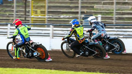 Three abreast: Nathan Greaves goes between team-mate Connor Mountain (red helmet) and Connor Coles t