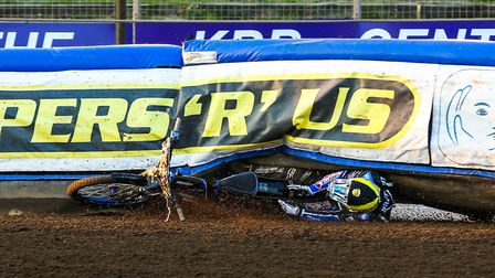 Newcastle's Ben Hopwood crashes into the fence in heat four last night. Photos: STEVE WALLER