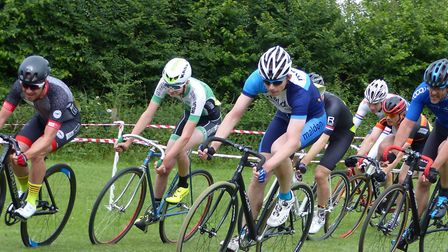 Coming through! The 8K leaders start to lap the field. From the left: Martin Smith, Laurence Lisher