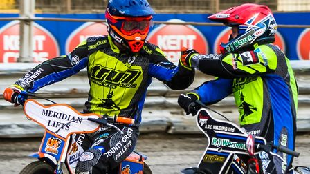 Danny King (red helmet) and Kyle Newman congratulate each other on a 5-1 in the opening heat against
