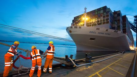 The mooring crew at work to secure the 21,413 TEU OOCL Hong Kong on her maiden voyage and first call