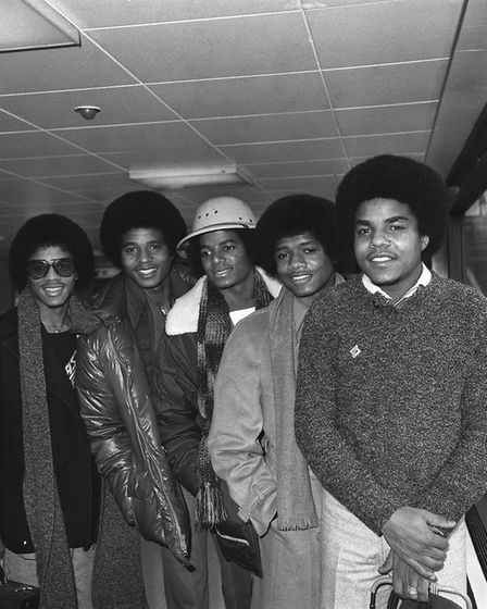 The Jacksons arriving at Heathrow Airport, London, in 1979. Left to right: Marlon, Jackie, Michael,